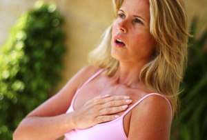 agefoto_rf_photo_of_woman_experiencing_chest_pain